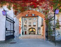 Colorful arch and medieval gate in old European city Stock Photography