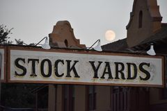 Stockyards and moon in FT Worth Texas. This image was taken in Fort Worth Texas while walking around the Stock yards royalty free stock photography