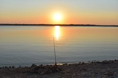 Fishing at sunset. This image was taken at Lake Benbrook in Texas in 2017 Stock Photo