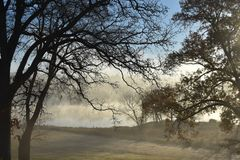 Fog at Lake Winnsboro. This image was taken at Lake Winnsboro in Texas right at sunrise Stock Photos