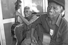 Two Old street musician and their old guitars royalty free stock image