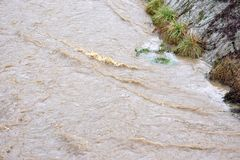 Image of water stream flood with strong current, Sarajevo, Europe, 03.02.2018. Image of water stream flood with strong current. City stream during rainy season stock photos
