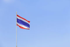 Image of  waving flag of Thailand against clear blue sky. Stock Photography