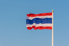 Image of waving Thai flag of Thailand with blue sky background Royalty Free Stock Photography
