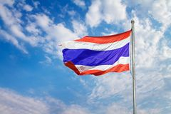 Image of waving Thai flag of Thailand with blue sky background. stock photography