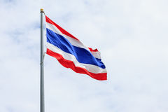 Image of waving Thai flag of Thailand with sky background. Stock Image