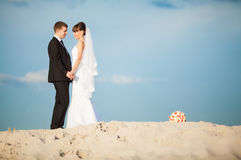 An image of wedding session on the beach Stock Photos