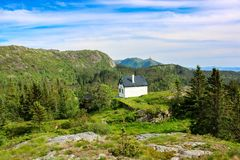 A Lone White Cabin on The Top of Mountain. Image of a white cabin in the forest on the top of Mount Floyen in Bergen, Hordaland County, Norway stock images