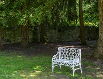 White Bench in a Park. Image of a white painted steel bench at Scone Palace, Perth, Scotland royalty free stock photo
