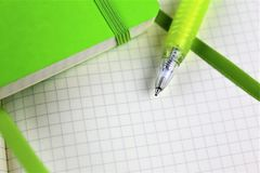 An image of a white paper block with a pen and copy space. Abstract Royalty Free Stock Images