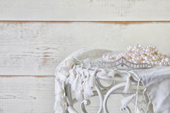 Image of white pearls necklace and diamond tiara on vintage table. vintage filtered. selective focus.  Royalty Free Stock Photo