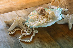 Image of white pearls necklace and seashells Royalty Free Stock Image