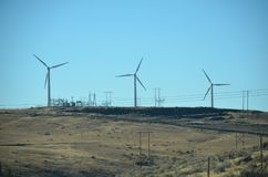 Wind turbines and power lines in Central Oregon Royalty Free Stock Photos