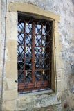 Medieval Castle Window with Cross Lattice Guard Stock Images