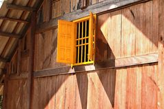 Yellow window on wooden house, Vietnam Stock Photos