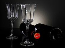 Wine bottles with glasses. Image of wine bottles with glasses stock photos