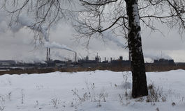 Image of winter landscape with industrial plant Stock Images