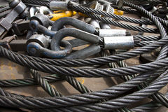 An image of Wire rope. Heavy duty steel wire rope sling with safety anchor shackle bolt in construction site Stock Photo