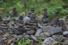 Image of wishing stones pyramid in the forest on Sakhalin island. stock images