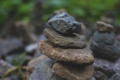 Image of wishing stones pyramid in the forest on Sakhalin island. Place of power. stock photos