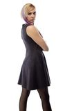 Image woman in artificial suede dress, half turned Stock Photography