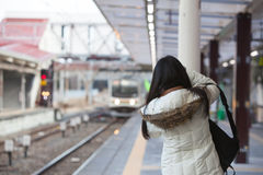 Image of Woman backpacker take photo train coming on station Royalty Free Stock Image