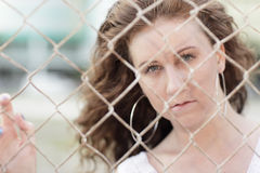 Image of a woman behind a fence Royalty Free Stock Photo