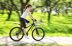 Image of woman with bicycle in a green park Royalty Free Stock Photos