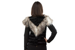 Image woman in black fur waistcoat from the back Stock Image