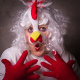 Expression woman in chicken costume. Image of a woman in a chicken costume, Easter concept Royalty Free Stock Images