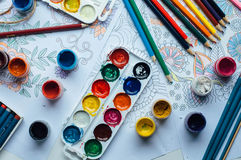 Image of woman coloring, adult coloring book trend, for stress r Stock Photo