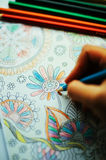 Image of woman coloring, adult coloring book trend, for stress r Royalty Free Stock Photos