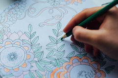Image of woman coloring, adult coloring book trend, for stress r Royalty Free Stock Image