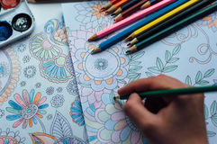 Image of woman coloring, adult coloring book trend, for stress r Royalty Free Stock Photo