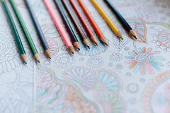 Image of woman coloring, adult coloring book trend, for stress r Stock Photos