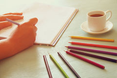 Image of woman coloring, adult coloring book trend, for stress relief. selective focus Stock Image