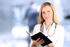 Image of woman doctor looking at camera Stock Photo