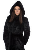 Image of woman in fake fur coat with hood Stock Photos