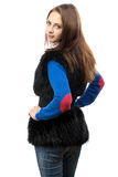 Image of woman in fake fur waistcoat from the back Stock Photography