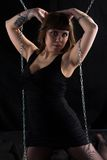 Image of woman with hands on head, chains Royalty Free Stock Images