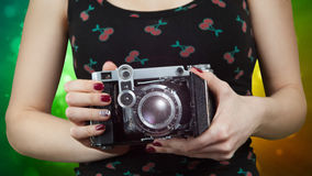 Image of woman hands holding vintage camera on the Stock Photos