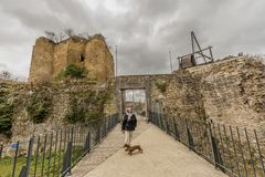 Image of a woman with her dog on the bridge leading to the entrance of the castle Franchimont royalty free stock photos