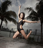 Image of a woman jumping Stock Images
