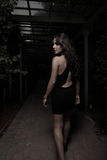 Image of a woman leaving. Into the dark royalty free stock photos