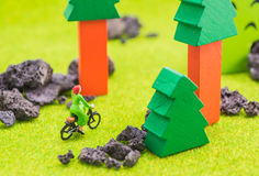 image of woman(mini figure dolls) with retro bicycle alone in a Royalty Free Stock Images
