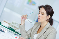 Image woman at office desk having headache Stock Photography