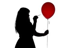 Image woman pierced with a needle balloon Stock Image