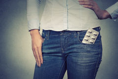 Image of a woman with pills in her pocket Royalty Free Stock Photos