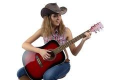 Image of woman playing guitar Stock Photos