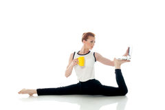 Image of woman posing in unreal pose with laptop. Isolated on white Stock Photography